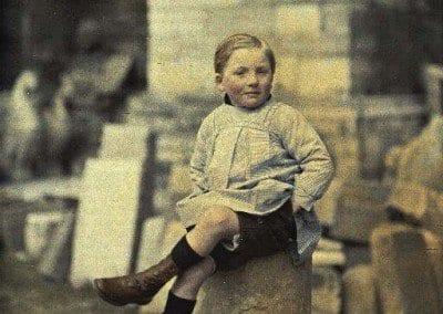 Young boy on stone debris