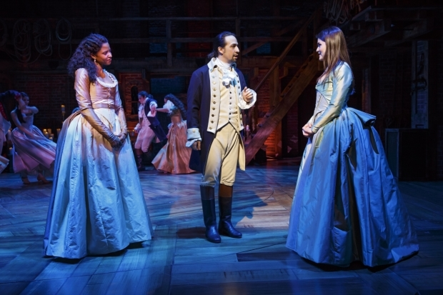 Hamilton star and creator Lin-Manuel Miranda as the musical's title character with Renée Elise Goldsberry (Angelica Schuyler) and Phillipa Soo (Eliza Hamilton)