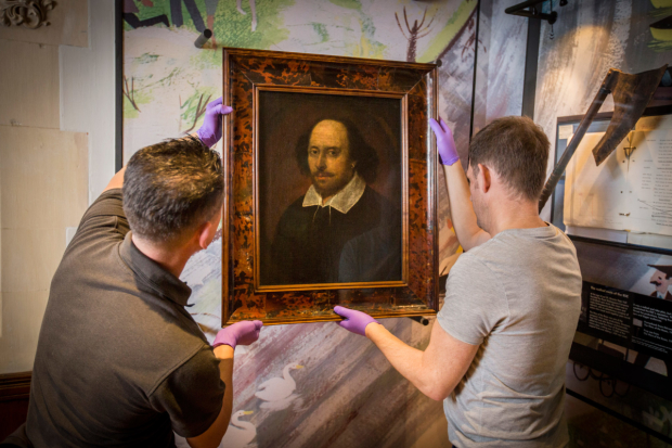The Chandos portrait being installed in The Play's The Thing exhibition
