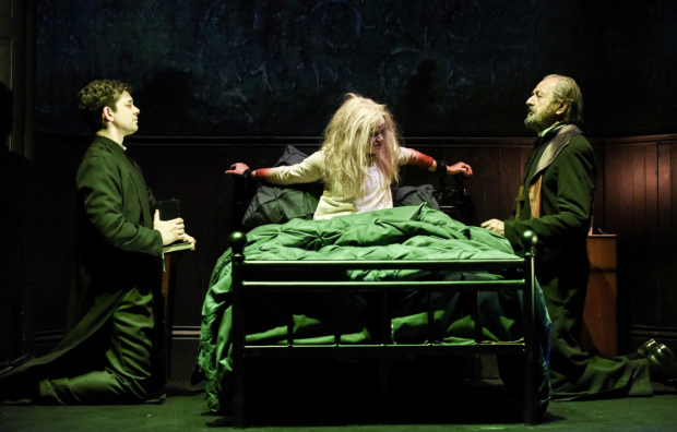Adam Garcia as Father Damien Karras, Clare Louise Connolly as Regan and Peter Bowles as Father Merrin in The Exorcist