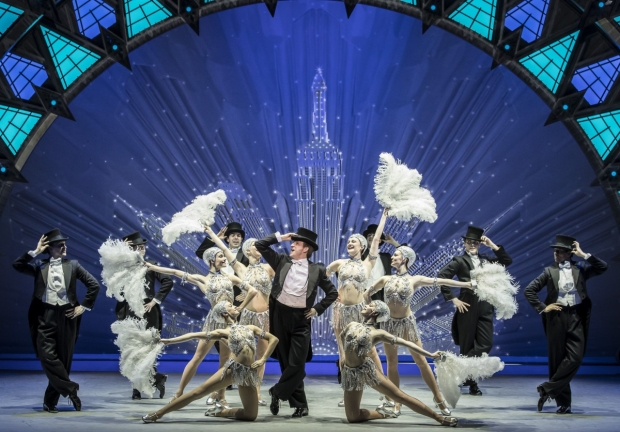Haydn Oakley, centre, with the cast of An American in Paris