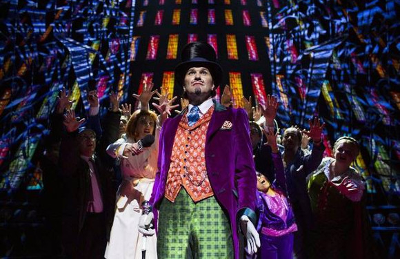 Golden ticket: Douglas Hodge (Willy Wonka) and the company