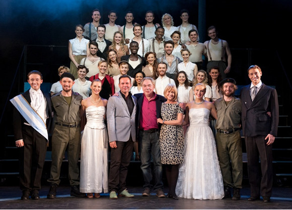 Andrew Lloyd Webber with the cast of Evita
