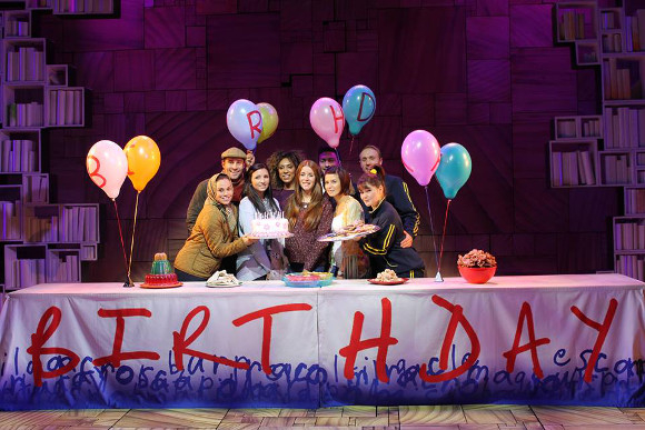 1,000,000th audience member Laura celebrates with the cast