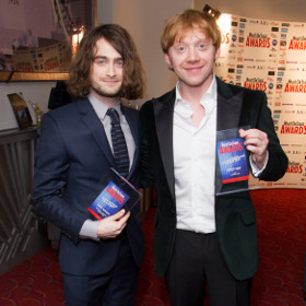 Daniel Radcliffe and Rupert Grint celebrating their award wins
