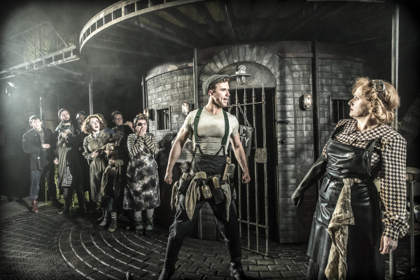 Richard Fleeshman, Jenna Russell and the cast of Urinetown