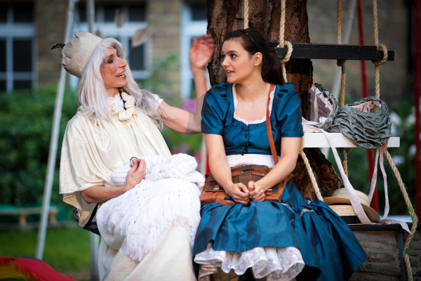 Valerie Cutko as White Queen and Laura Wickham as Alice