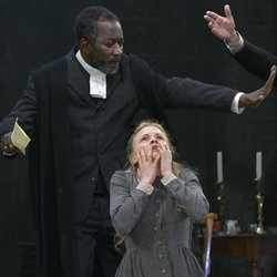 Joseph Mydell (Gov Giles Danforth) and Kate Phillips (Abigail Williams) in Arthur Miller's The Crucible directed by James Brining
