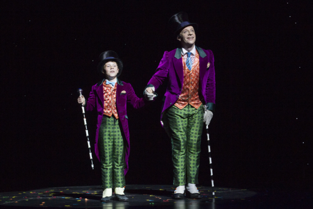 London Zachary Loonie (Charlie Bucket) and Jonathan Slinger (Willy Wonka) during the curtain call for the 2nd birthday of Charlie and the Chocolate Factory at the Theatre Royal Drury Lane, London, England on 25th June 2015. (Credit should read: Dan Wooller/wooller.com). Paid use only. No Syndication