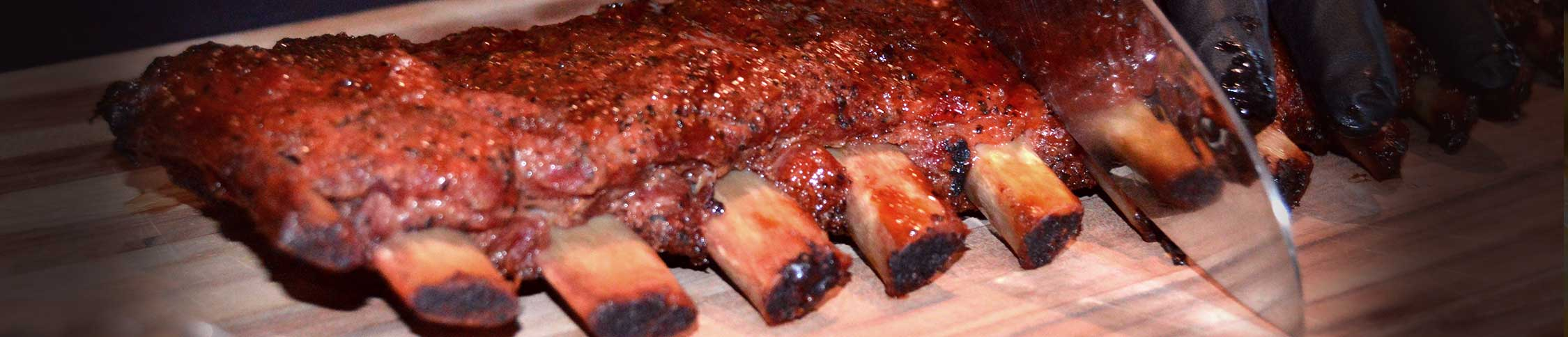 St. Louis style ribs being sliced