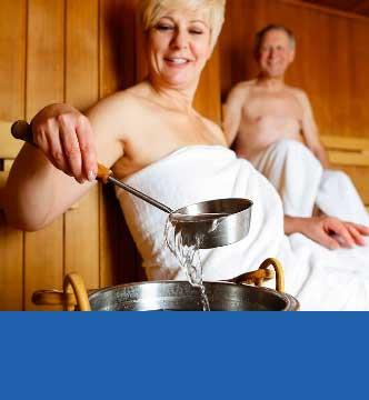 Couple using sauna at home