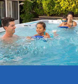 Family using a swim spa