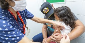 Girl getting measles vaccination