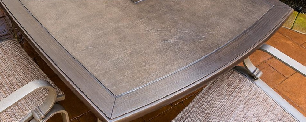 Cabretta Faux-Leather Polymer Table Tops by Tropitone