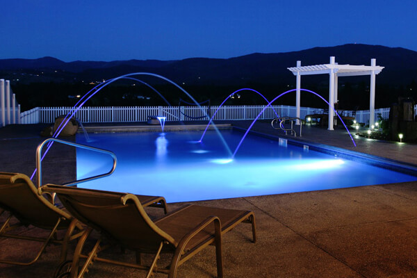 Inground pools at night Colored Light Special Swimming Pool Features Garden Guides Residential Inground Swimming Pools Pool World Spokane