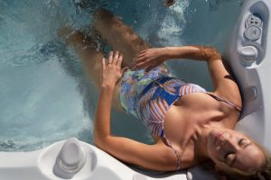 woman in hot tub getting neck and shoulder relief