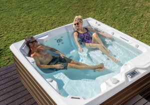 couple in tub relaxing   home spa hot tub experience tips