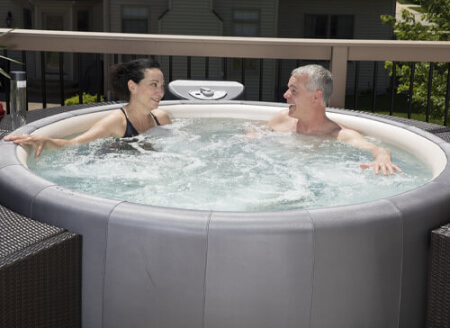Couple in soft tub hot tub in Metairie, LA