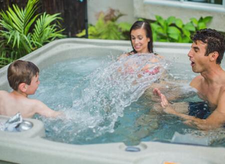 Plug-in hot tubs in backyard