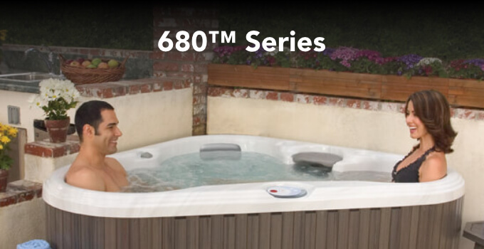 Lifestyle image of a family in a 680 Series spa