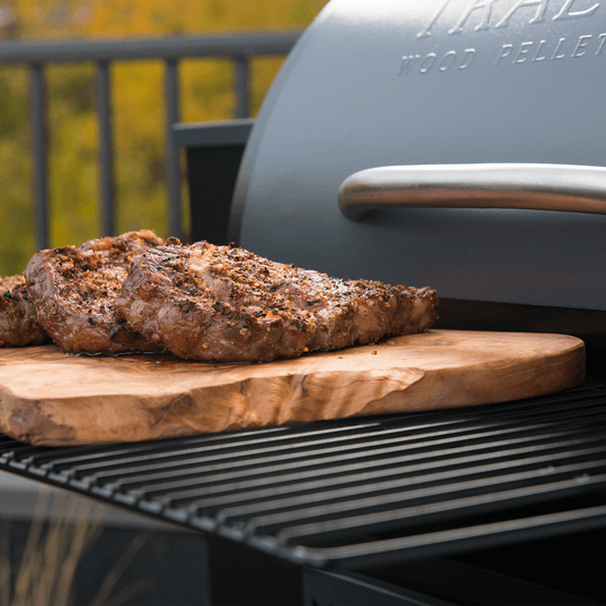 Traeger Grill with cooked steaks