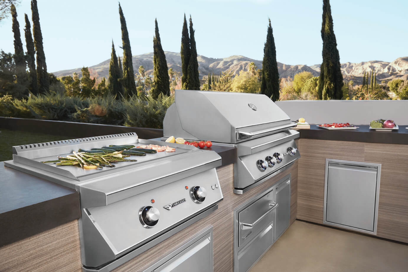 Twin Eagle outdoor kitchen Premium grill cooking asparagus and peppers