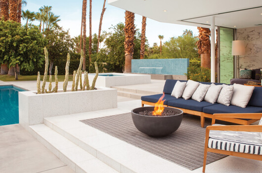 Rose Urth fire bow with patio by Brown Jordan
