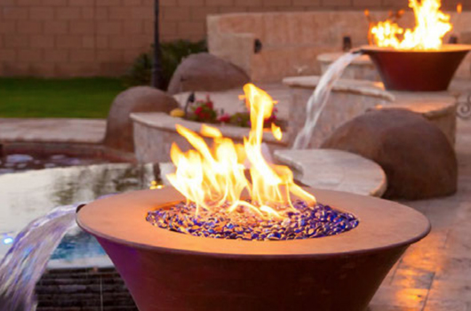 Top Fire's Copper Fire water bowl with waterfall into a pool