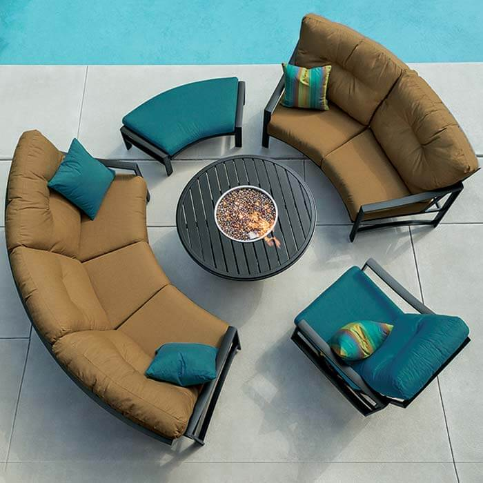 Tropitone's Kenzo Crescent Cushion surrounding a fire pit poolside