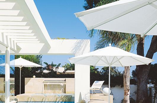 BASTA SOLE® Umbrella at a resort on a sunny day