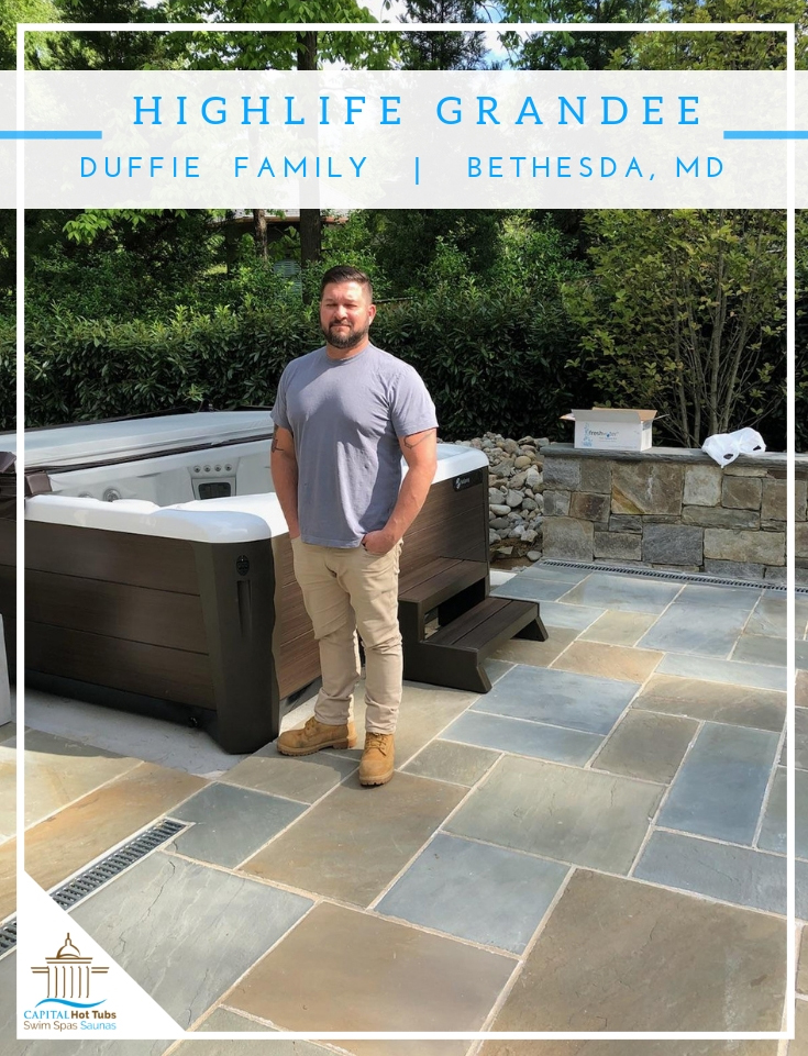 man standing next to hot tub on back slate patio in Bethesda, md