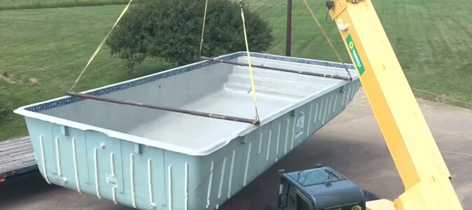 Fiberglass Pool Shell Delivery Family Image