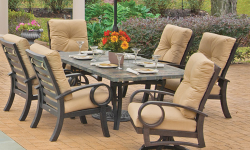 Outdoor dining table and chair set by Mallin Casual Furniture