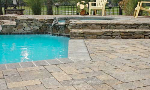 Outdoor Pavestone Pavers installed around an in-ground swimming pool in Cornelius, NC