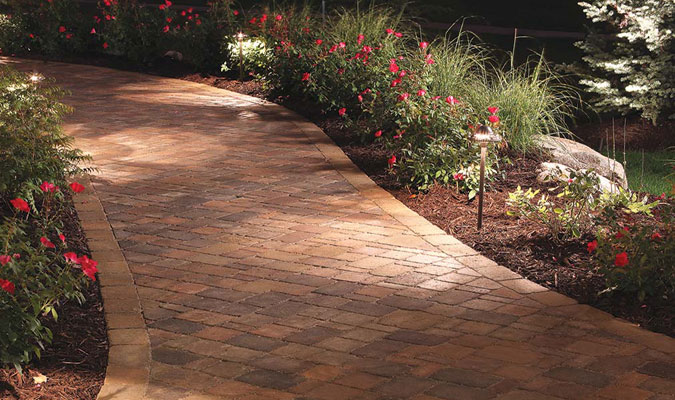 A night-time picture of a Pavestone walkway in Charlotte, NC