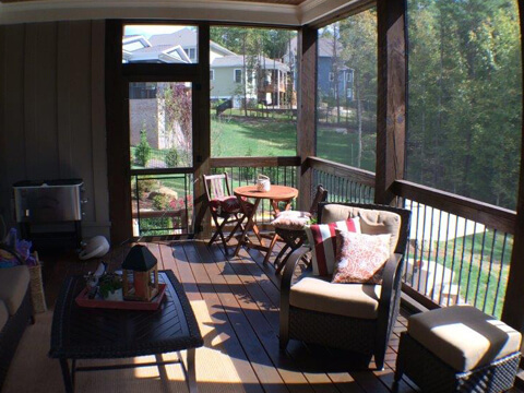 Outdoor living area with patio furniture and enclosed windows