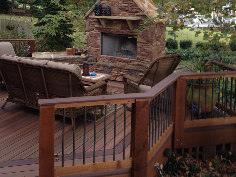 Installed backyard deck with fireplace and patio furniture