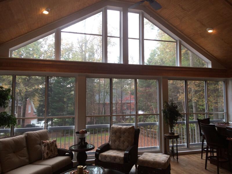 Backyard deck surrounded by EZE Breeze Windows