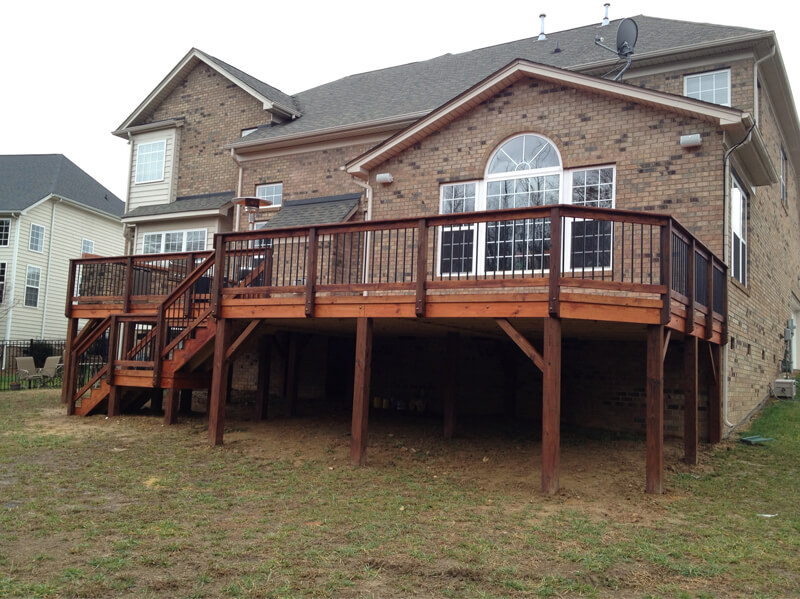 Durable deck in back of house with backyard