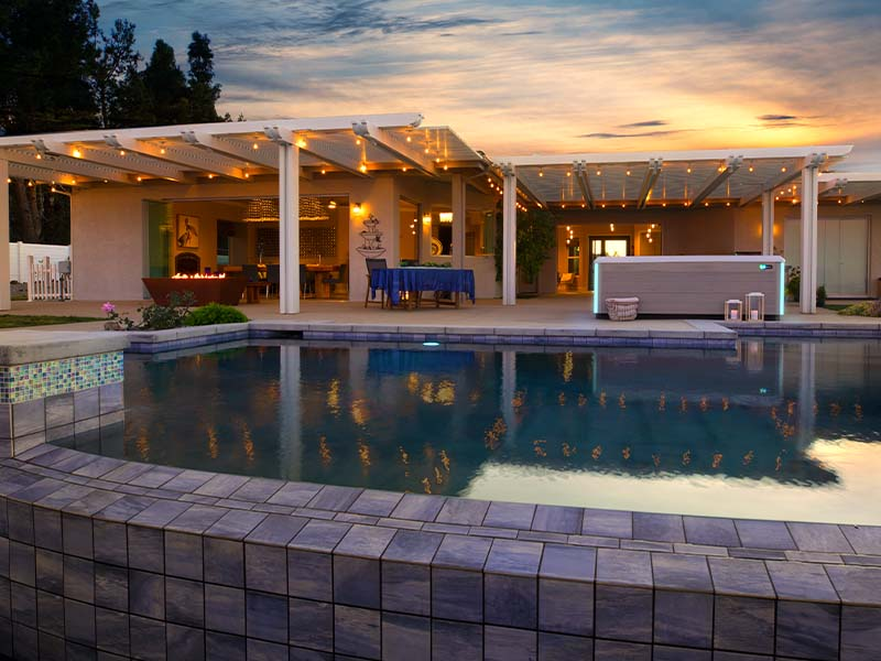 Hot Spring Spas Limelight Collection in beautiful backyard with sunset