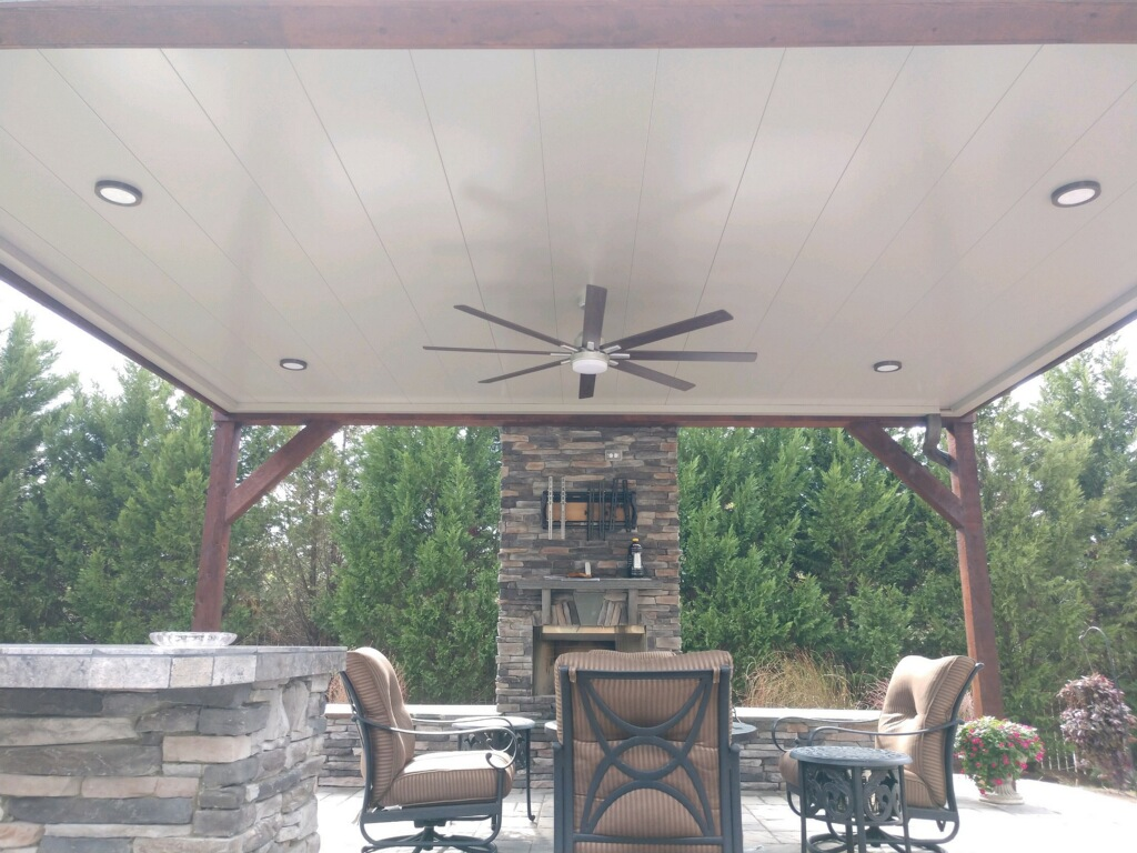 COnstructed porch with outdoor kitchen and fireplace