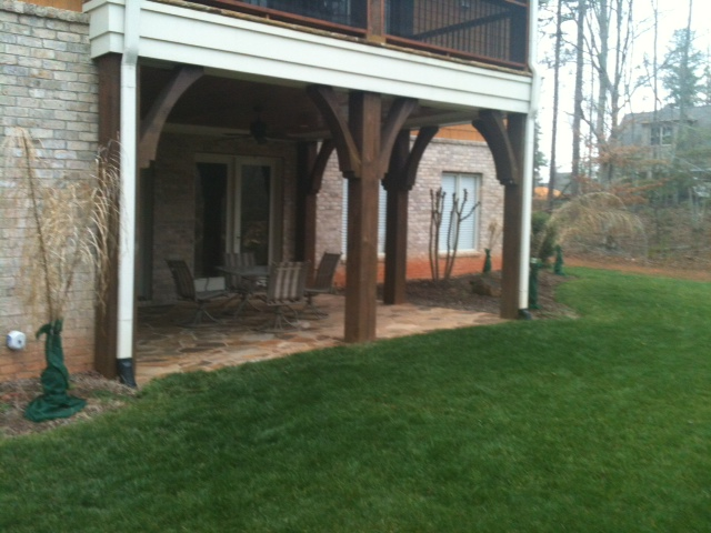 Constructed deck area with patio