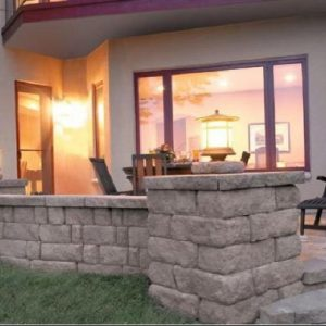 Natural stone patio and wall constructed in backyard