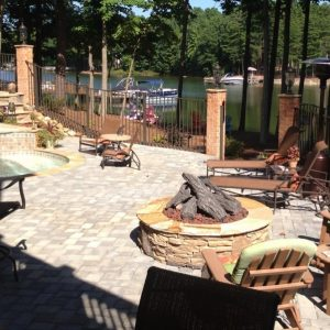 Backyard natural stone patio construction