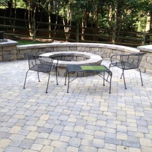 Fun Outdoor Living constructed stone paved patio with firepit
