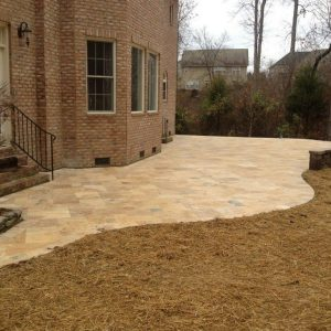 construction of a stone patio walkway