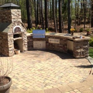 Outdoor kitchen construction with paved patio