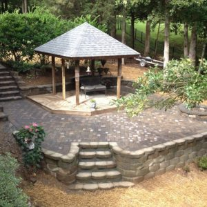 Overhead view of constructed paved patio and walkway in backyard