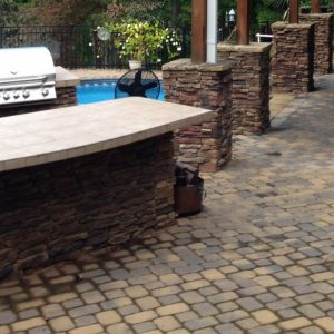 Constructed paved patio and walkway with outdoor kitchen