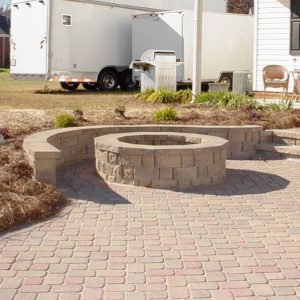 Stone walkway and fire pit installed on patio